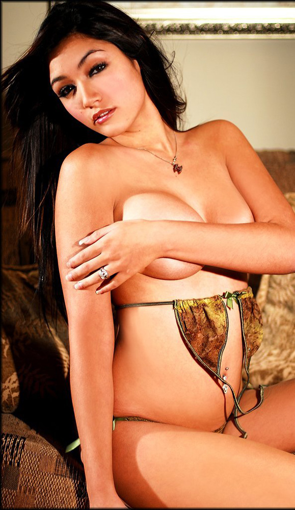 Stunning girl wearing lingerie and teasing