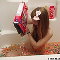 Dolly Little bathing in fruit loops - image